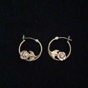 Gold hoop earrings with rose detail